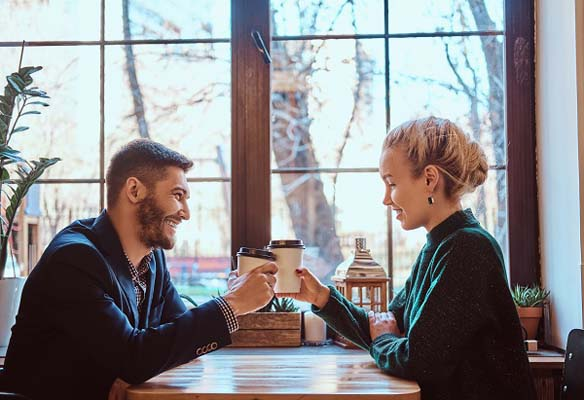 Smiling couple drinking coffee together